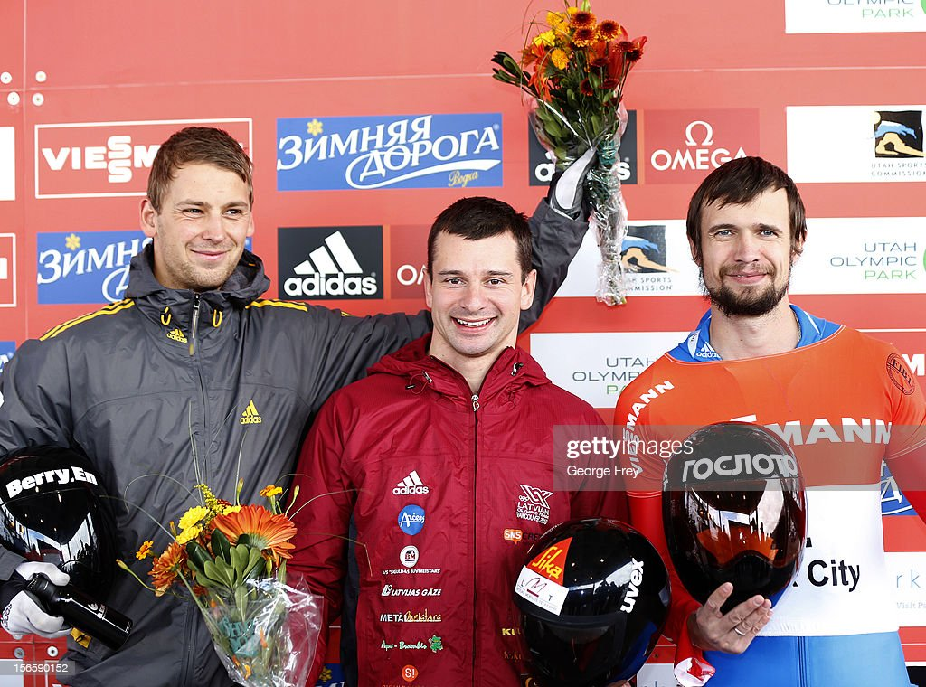 Martins Dukurs of Latvia (C), Alexander Kroeckel of Germany (L), and Alexander Tretjyakov of Russia (R) celebrate their first, second and third place finishes, respectively, in the FIBT men's skeleton world cup on November 17, 2012 at Utah Olympic Park in Park City, Utah.