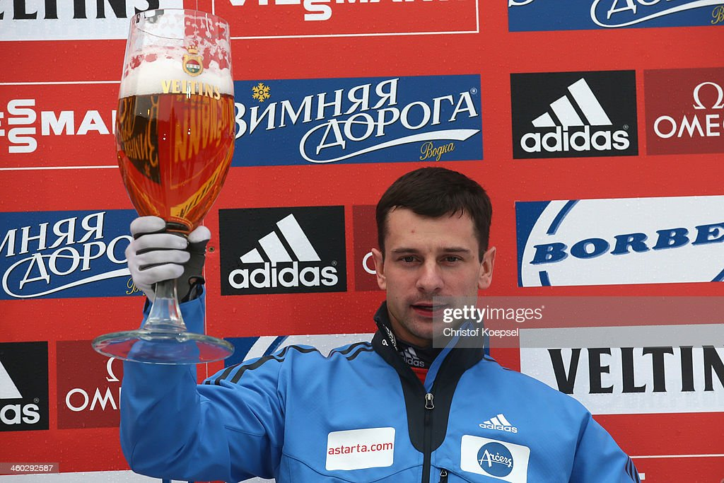 <a gi-track='captionPersonalityLinkClicked' href=/galleries/search?phrase=Martins+Dukurs&family=editorial&specificpeople=4876286 ng-click='$event.stopPropagation()'>Martins Dukurs</a> of Latvia celebrates with beer on the podium after winning the mens skeleton competition during the FIBT Bob & Skeleton World Cup at Bobbahn Winterberg on January 3, 2014 in Winterberg, Germany.
