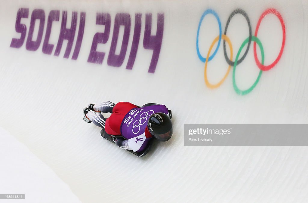 <a gi-track='captionPersonalityLinkClicked' href=/galleries/search?phrase=Martins+Dukurs&family=editorial&specificpeople=4876286 ng-click='$event.stopPropagation()'>Martins Dukurs</a> of Latvia makes a run during a Men's Skeleton training session on Day 4 of the Sochi 2014 Winter Olympics at the Sanki Sliding Center on February 11, 2014 in Sochi, Russia.