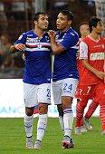 Martins Eder of UC Sampdoria celebrates with team mate Luis Muriel after scoring a goal during the Serie A match between UC Sampdoria and Carpi FC at...
