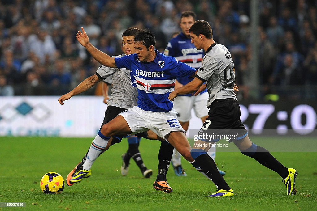 Martins Eder (C) of UC Sampdoria is challenged by <a gi-track='captionPersonalityLinkClicked' href=/galleries/search?phrase=Carlos+Carmona&family=editorial&specificpeople=3035631 ng-click='$event.stopPropagation()'>Carlos Carmona</a> (L) and Nica Constantin of Atalanta BC during the Serie A match between UC Sampdoria and Atalanta BC at Stadio Luigi Ferraris on October 26, 2013 in Genoa, Italy.