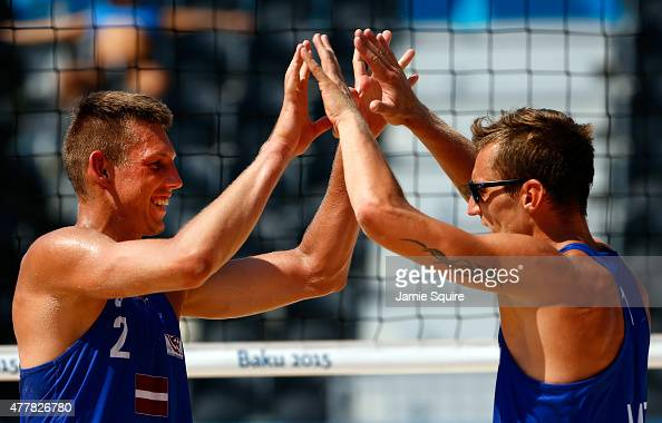 Martins Plavins and Haralds Regza of Lithuania celebrate after defeating Neilton Santos and Iaroslav Rudykh of Azerbaijan in the Beach Volleyball...