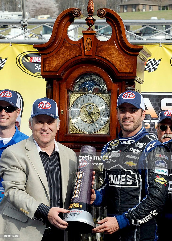 Martinsville Speedway President Clay Campbell (L) and Jimmie Johnson, driver of the #48 Lowe's Chevrolet, celebrate in Victory Lane after winning the NASCAR Sprint Cup Series STP Gas Booster 500 on April 7, 2013 at Martinsville Speedway in Ridgeway, Virginia.
