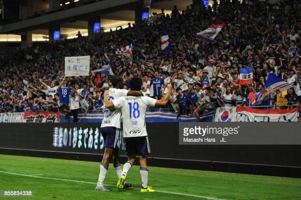 Martinus and Keita Endo of Yokohama FMarinos applaud supporters after their 21 victory in the JLeague J1 match between Gamba Osaka and Yokohama...