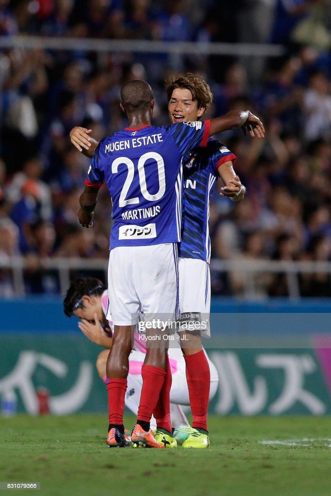 Martinus (L) and Takahiro Ogihara (R) of Yokohama F.Marinos celebrate their 1-0 victory in the J.League J1 match between Yokohama F.Marinos and Sagan Tosu at Nippatsu Mitsuzawa Stadium on August 13, 2017 in Yokohama, Kanagawa, Japan.