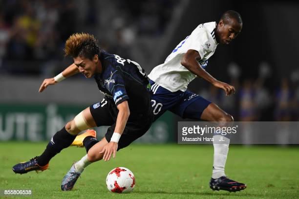 Martinus of Yokohama FMarinos and Hwang Ui Jo of Gamba Osaka compete for the ball during the JLeague J1 match between Gamba Osaka and Yokohama...
