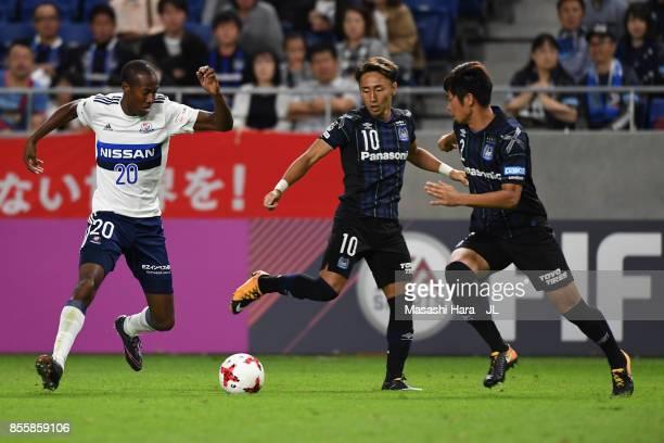 Martinus of Yokohama FMarinos and Shu Kurata of Gamba Osaka compete for the ball during the JLeague J1 match between Gamba Osaka and Yokohama...