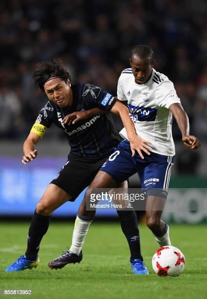 Martinus of Yokohama FMarinos and Yasuhito Endo of Gamba Osaka compete for the ball during the JLeague J1 match between Gamba Osaka and Yokohama...