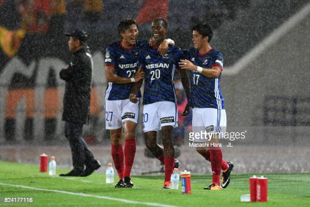 Martinus of Yokohama FMarinos celebrates scoring the opening goal with his team mates Ken Matsubara and Cayman Togashi during the JLeague J1 match...