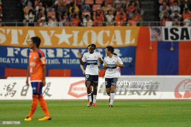 Martinus of Yokohama FMarinos celebrates scoring the opening goal with his team mate Naoki Maeda during the JLeague J1 match between Albirex Niigata...