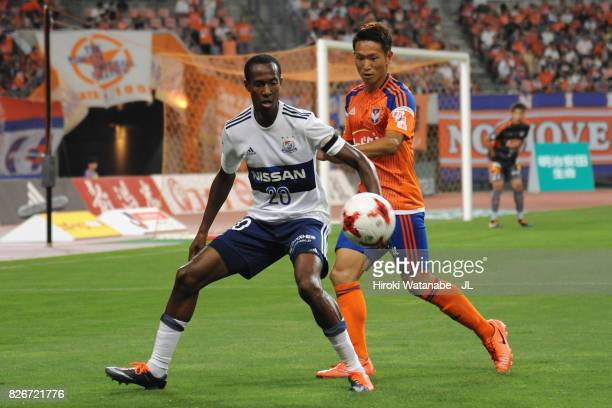 Martinus of Yokohama FMarinos controls the ball under pressure of Kei Koizumi of Albirex Niigata during the JLeague J1 match between Albirex Niigata...