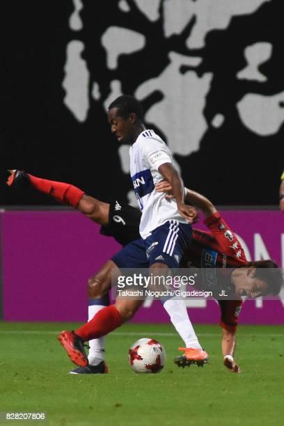 Martinus of Yokohama FMarinos controls the ball under pressure of Shingo Hyodo of Consadole Sapporo during the JLeague J1 match between Consadole...