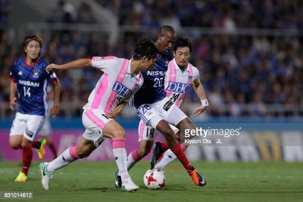 Martinus of Yokohama FMarinos controls the ball under pressure of Yoshiki Takahashi and Jung Seung Hyun of Sagan Tosu during the JLeague J1 match...