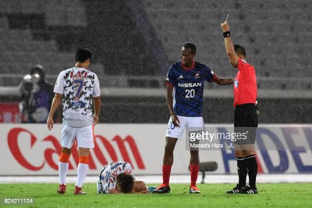 Martinus of Yokohama FMarinos is shown a yellow card by referee Minoru Tojo after fouling on Ko Matsubara of Shimizu SPulse during the JLeague J1...