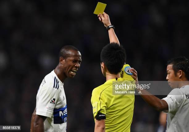 Martinus of Yokohama FMarinos is shown a yellow card by referee Masuya Ueda during the JLeague J1 match between Gamba Osaka and Yokohama FMarinos at...