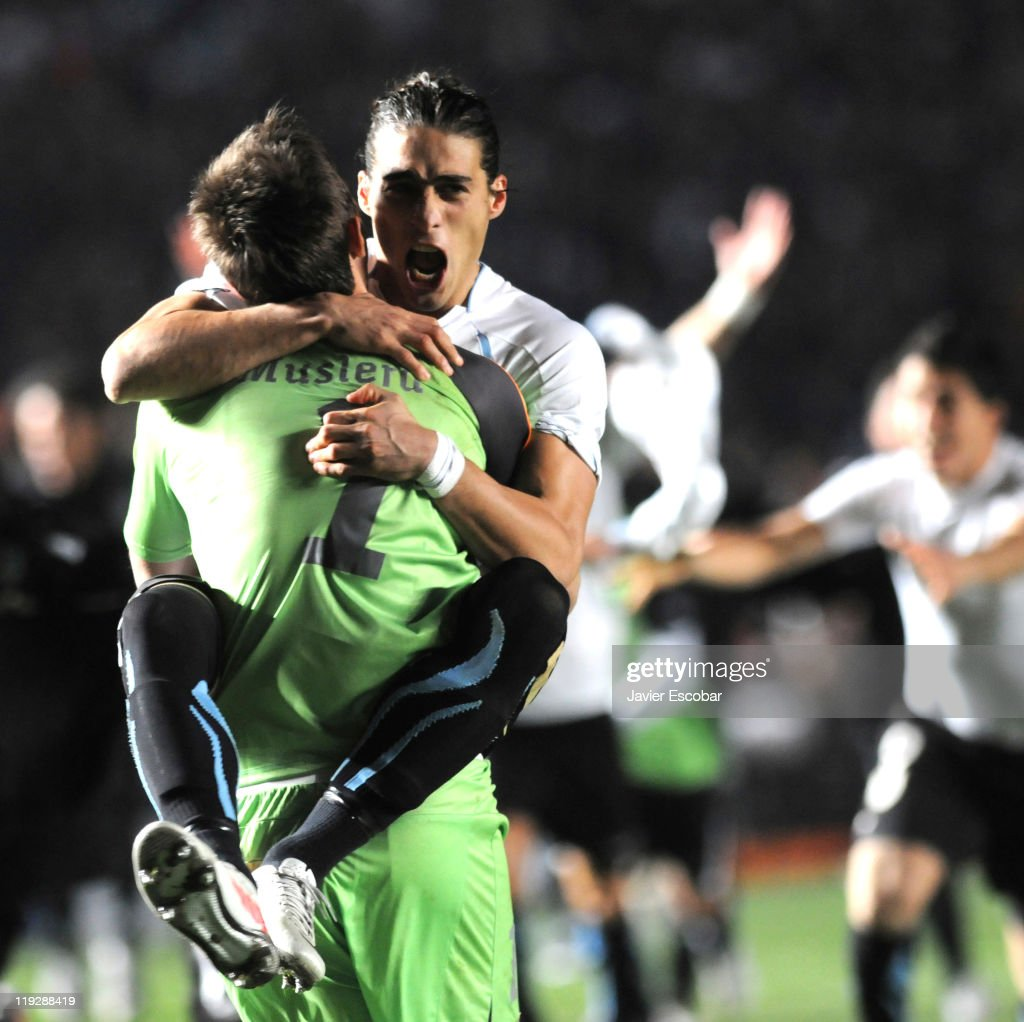 Martín Cáceres and Fernando Muslera of Uruguay celebrate after the victory between Argentina and Uruguay as part of the Cuarter Final of Copa America...