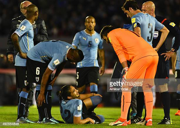 Martín Cáceres of Uruguay lies injured during a match between Uruguay and Colombia as part of FIFA 2018 World Cup Qualifier at Centenario Stadium on...