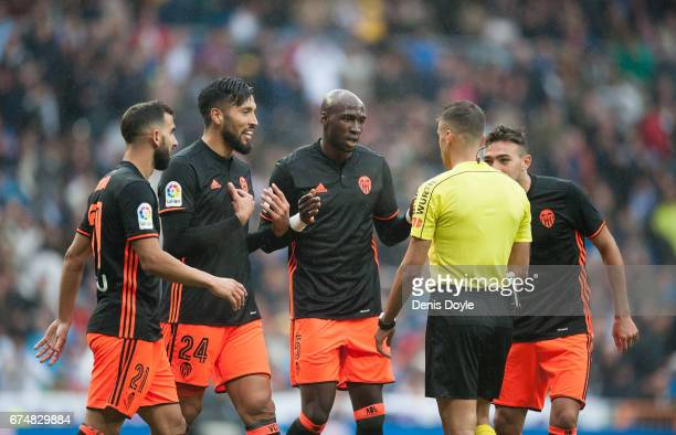 Martn Montoya Martn Montoya and Eliaquim Mangala of Valencia CF argue with referee Jesus Manzano after he awarded a penalty kick during the La Liga...