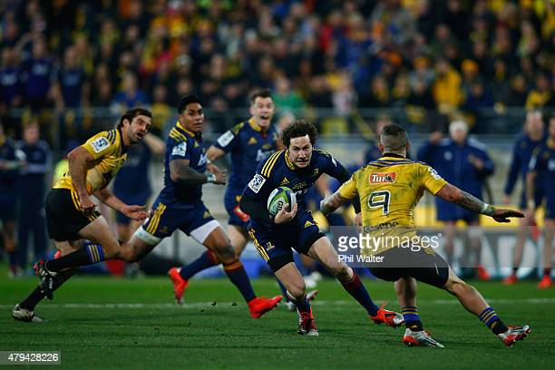 Marty Banks of the Highlanders is tackled during the Super Rugby Final match between the Hurricanes and the Highlanders at Westpac Stadium on July 4...