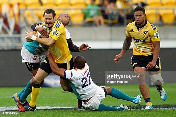 Marty Banks of the Hurricanes is tackled during the round five Super Rugby match between the Hurricanes and the Cheetahs at Westpac Stadium on March...