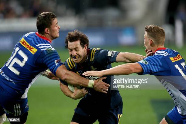 Marty Banks of the Otago Highlanders is tackled by Western Stormers' Dan Kriel and Robert du Preez during the Super Rugby match between the Otago...