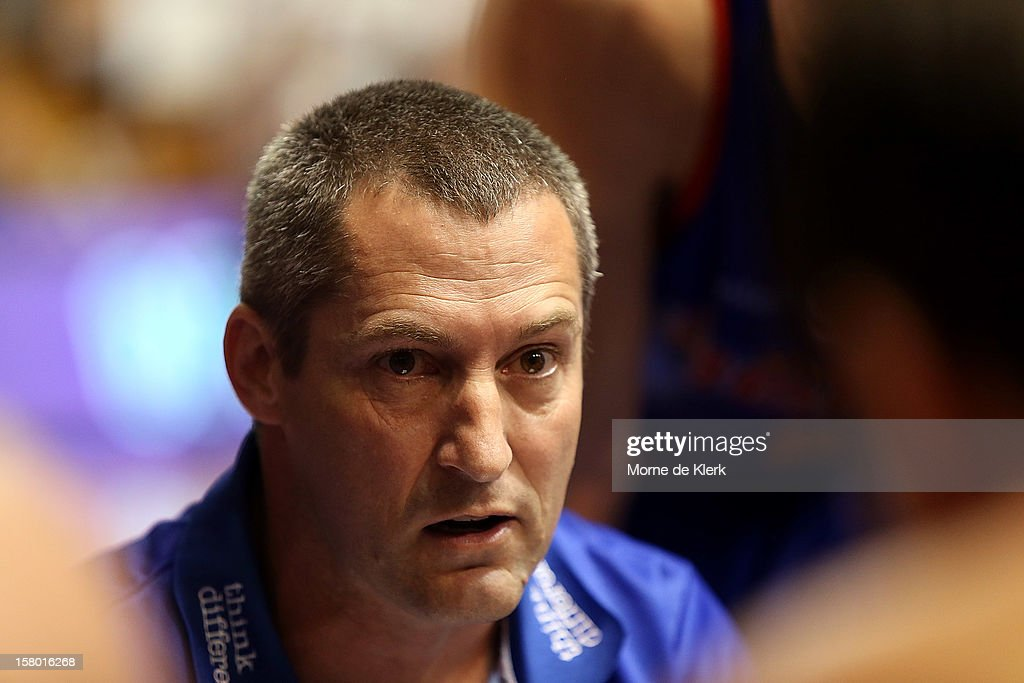 Marty Clarke of Adelaide speaks to the team at a time-out during the round ten NBL match between the Adelaide 36ers and the Perth Wildcats at Adelaide Arena on December 9, 2012 in Adelaide, Australia.