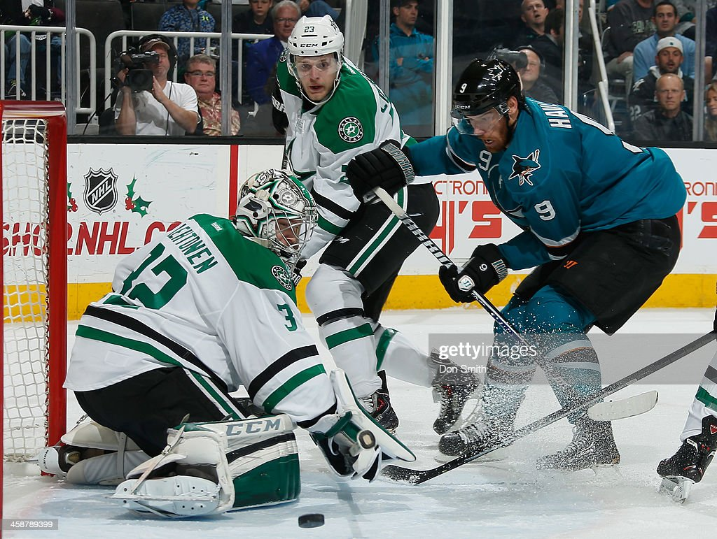 Marty Havlat #9 of the San Jose Sharks battles to get one past the net against <a gi-track='captionPersonalityLinkClicked' href=/galleries/search?phrase=Kari+Lehtonen&family=editorial&specificpeople=211612 ng-click='$event.stopPropagation()'>Kari Lehtonen</a> #32 and <a gi-track='captionPersonalityLinkClicked' href=/galleries/search?phrase=Kevin+Connauton&family=editorial&specificpeople=6271014 ng-click='$event.stopPropagation()'>Kevin Connauton</a> #23 of the Dallas Stars during an NHL game on December 21, 2013 at SAP Center in San Jose, California.