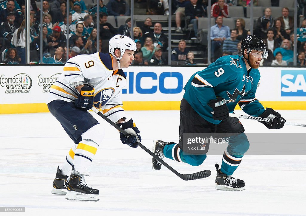 Marty Havlet #9 of the San Jose Sharks skates to the puck against Steve Ott #9 of the Buffalo Sabres during an NHL game on November 5, 2013 at SAP Center in San Jose, California.