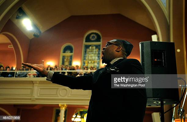 Marty Lamar of Turner Memorial AME church in Hyattsville MD led the Turner choir is a rousing gospel hymn He later also led a joint choir of his...