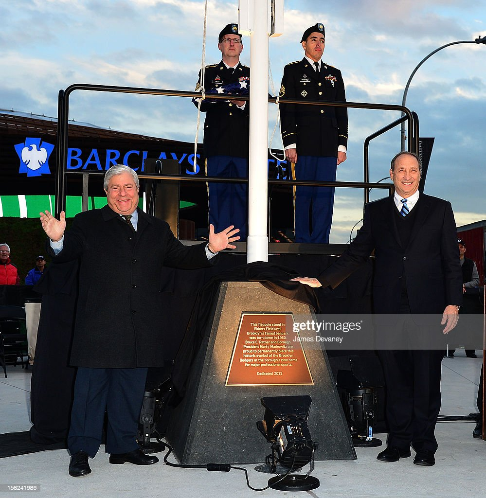 Marty Markowitz and Bruce Ratner attend the Ebbets Field Flagpole Commemoration at the Barclays Center on December 11, 2012 in the Brooklyn borough of New York City.