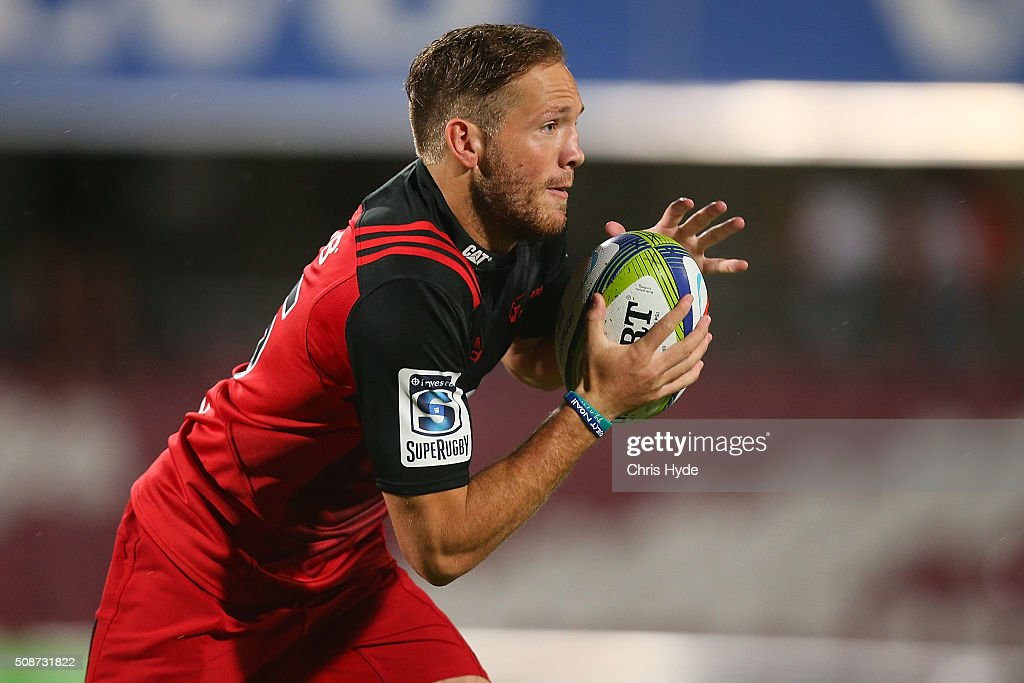 Marty McKenzie of Crusaders runs the ball during the Super Rugby pre-season match between the Reds and the Crusaders at Ballymore Stadium on February 6, 2016 in Brisbane, Australia.