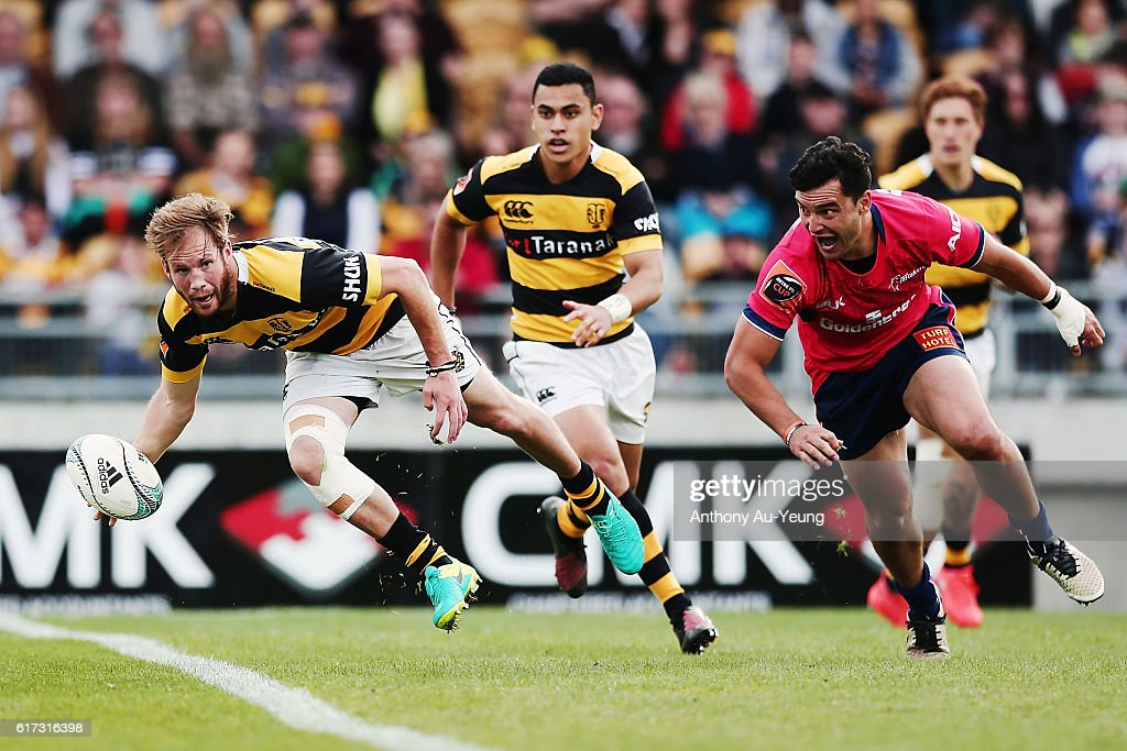 Marty McKenzie of Taranaki looks to get away from James Lowe of Tasman during the Mitre 10 Cup Semi Final match between Taranaki and Tasman on October 23, 2016 in New Plymouth, New Zealand.