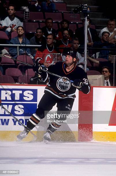 Marty McSorley of the Edmonton Oilers skates on the ice during an NHL game against the New Jersey Devils on October 17 1998 at the Continental...