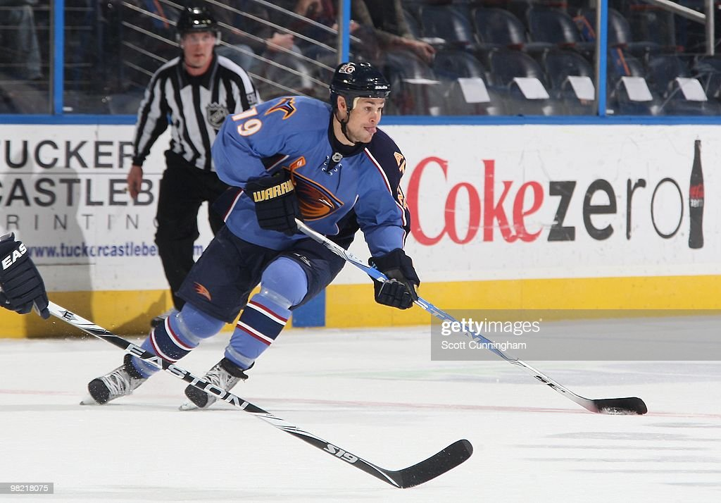 Marty Reasoner of the Atlanta Thrashers carries the puck against the Nashville Predators at Philips Arena on March 9 2010 in Atlanta Georgia