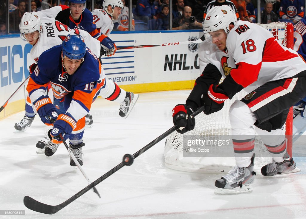 <a gi-track='captionPersonalityLinkClicked' href=/galleries/search?phrase=Marty+Reasoner&family=editorial&specificpeople=203281 ng-click='$event.stopPropagation()'>Marty Reasoner</a> #16 of the New York Islanders and Jim O'Brien #18 of the Ottawa Senators lunge for the puck at Nassau Veterans Memorial Coliseum on March 3, 2013 in Uniondale, New York.