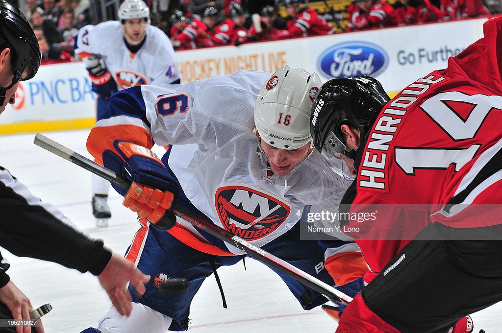 <a gi-track='captionPersonalityLinkClicked' href=/galleries/search?phrase=Marty+Reasoner&family=editorial&specificpeople=203281 ng-click='$event.stopPropagation()'>Marty Reasoner</a> #16 of the New York Islanders battles <a gi-track='captionPersonalityLinkClicked' href=/galleries/search?phrase=Adam+Henrique&family=editorial&specificpeople=4043225 ng-click='$event.stopPropagation()'>Adam Henrique</a> # 14 of the New Jersey Devils at the face at the Prudential Center on April 1, 2013 in Newark, New Jersey. Islanders win 3-1 over the Devils.