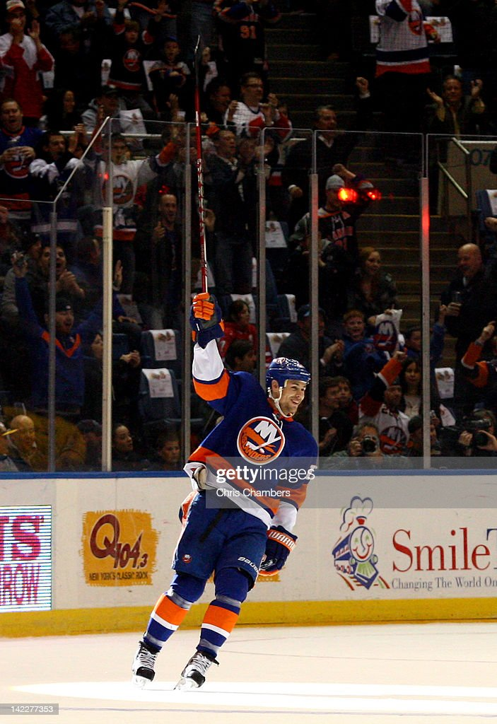 <a gi-track='captionPersonalityLinkClicked' href=/galleries/search?phrase=Marty+Reasoner&family=editorial&specificpeople=203281 ng-click='$event.stopPropagation()'>Marty Reasoner</a> #16 of the New York Islanders celebrates after he scored a goal in the first period against the Pittsburgh Penguins at Nassau Veterans Memorial Coliseum on March 29, 2012 in Uniondale, New York. The goal was Reasoner's first as a member of the Islanders.