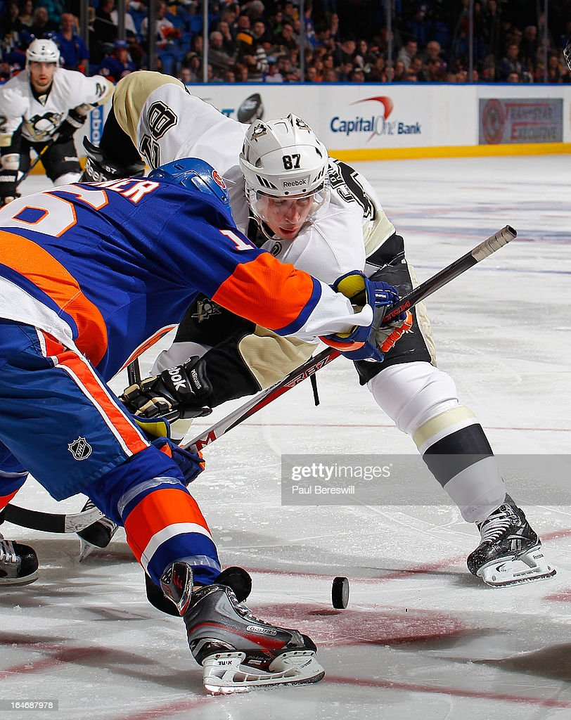 Marty Reasoner of the New York Islanders faces off against Sidney Crosby of the Pittsburgh Penguins in an NHL hockey game at Nassau Veterans Memorial...