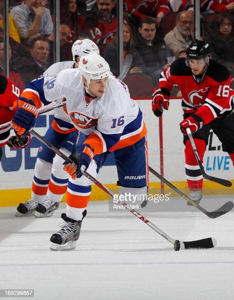 Marty Reasoner of the New York Islanders plays the puck against the New Jersey Devils during the game at the Prudential Center on April 1 2013 in...