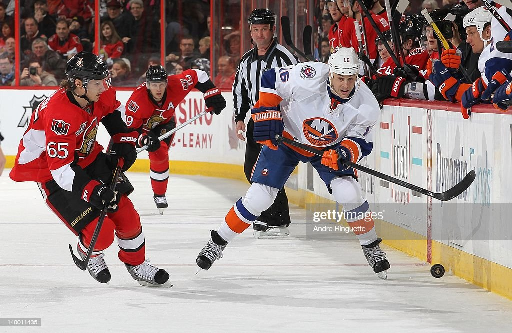 <a gi-track='captionPersonalityLinkClicked' href=/galleries/search?phrase=Marty+Reasoner&family=editorial&specificpeople=203281 ng-click='$event.stopPropagation()'>Marty Reasoner</a> #16 of the New York Islanders shoots the puck past <a gi-track='captionPersonalityLinkClicked' href=/galleries/search?phrase=Erik+Karlsson&family=editorial&specificpeople=5370939 ng-click='$event.stopPropagation()'>Erik Karlsson</a> #65 of the Ottawa Senators at Scotiabank Place on February 26, 2012 in Ottawa, Ontario, Canada.