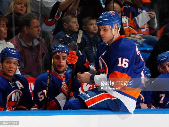 Marty Reasoner of the New York Islanders sits on the boards by the bench during a break in action in an NHL hockey game against the Pittsburgh...