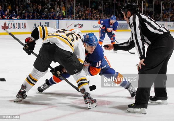 Marty Reasoner of the New York Islanders skates against David Krejci of the Boston Bruins at Nassau Veterans Memorial Coliseum on February 26 2013 in...