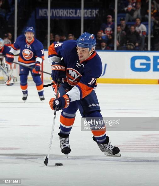 Marty Reasoner of the New York Islanders skates against the Carolina Hurricanes at the Nassau Veterans Memorial Coliseum on February 24 2013 in...