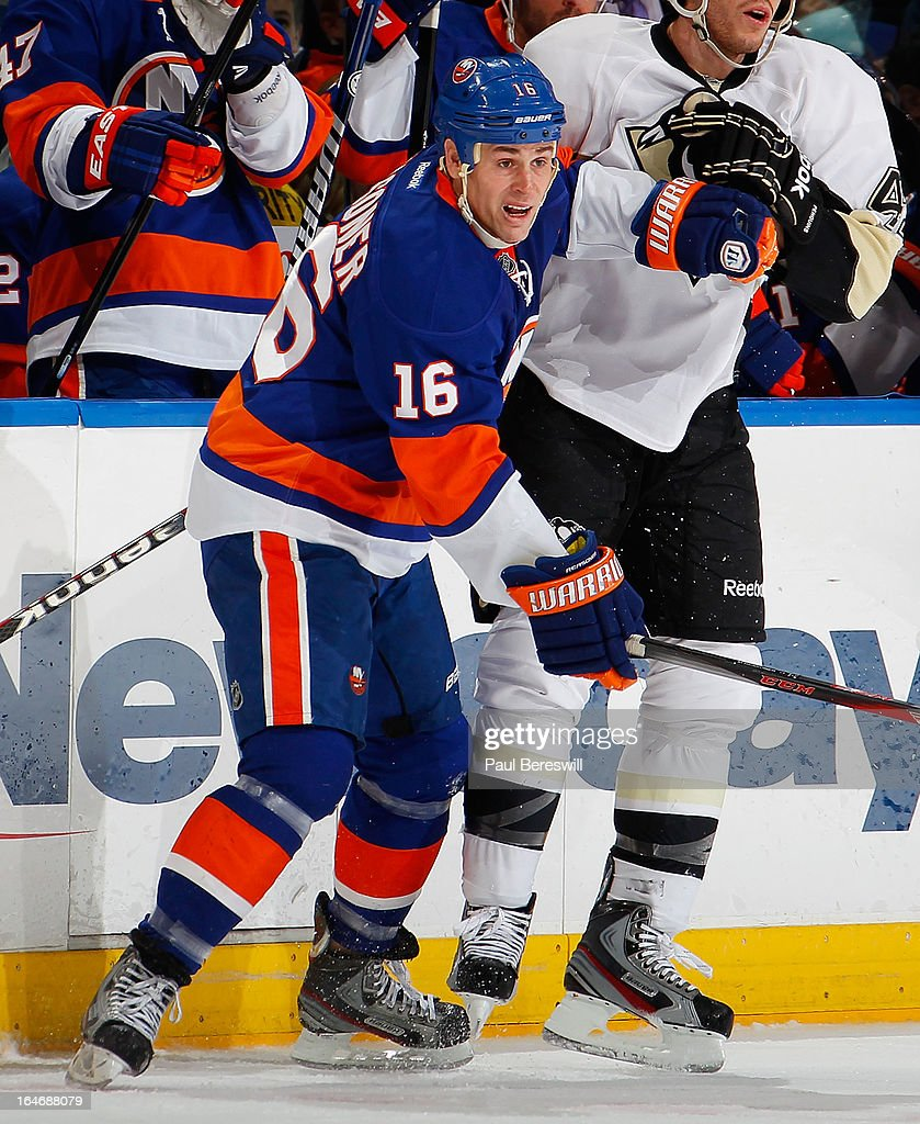 Marty Reasoner of the New York Islanders skates in an NHL hockey game against the Pittsburgh Penguins at Nassau Veterans Memorial Coliseum on March...