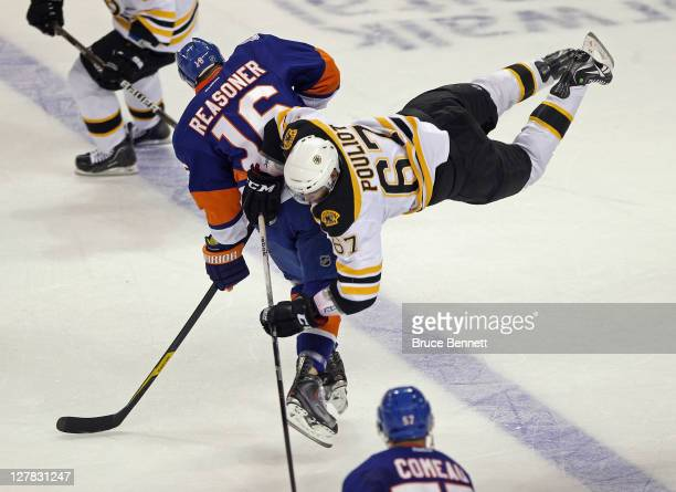 Marty Reasoner of the New York Islanders steps into Benoit Pouliot of the Boston Bruins at the Webster Bank Arena on October 1 2011 in Bridgeport...
