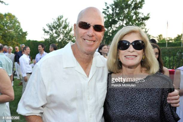 Marty Romm and Karen Romm attend GODS LOVE WE DELIVERMid Summer Night Drinks Benefit at Home of Chad A Leat on June 19 2010 in Bridgehampton New York