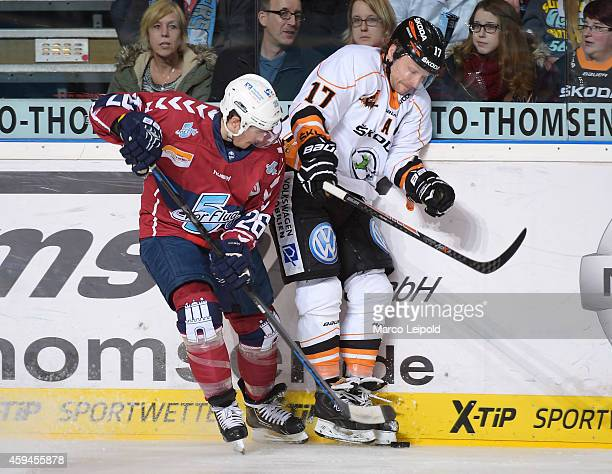 Marty Sertich of the Hamburg Freezers and Sebastian Furchner of the Grizzly Adams Wolfsburg duel during the game between Hamburg Freezers and Grizzly...