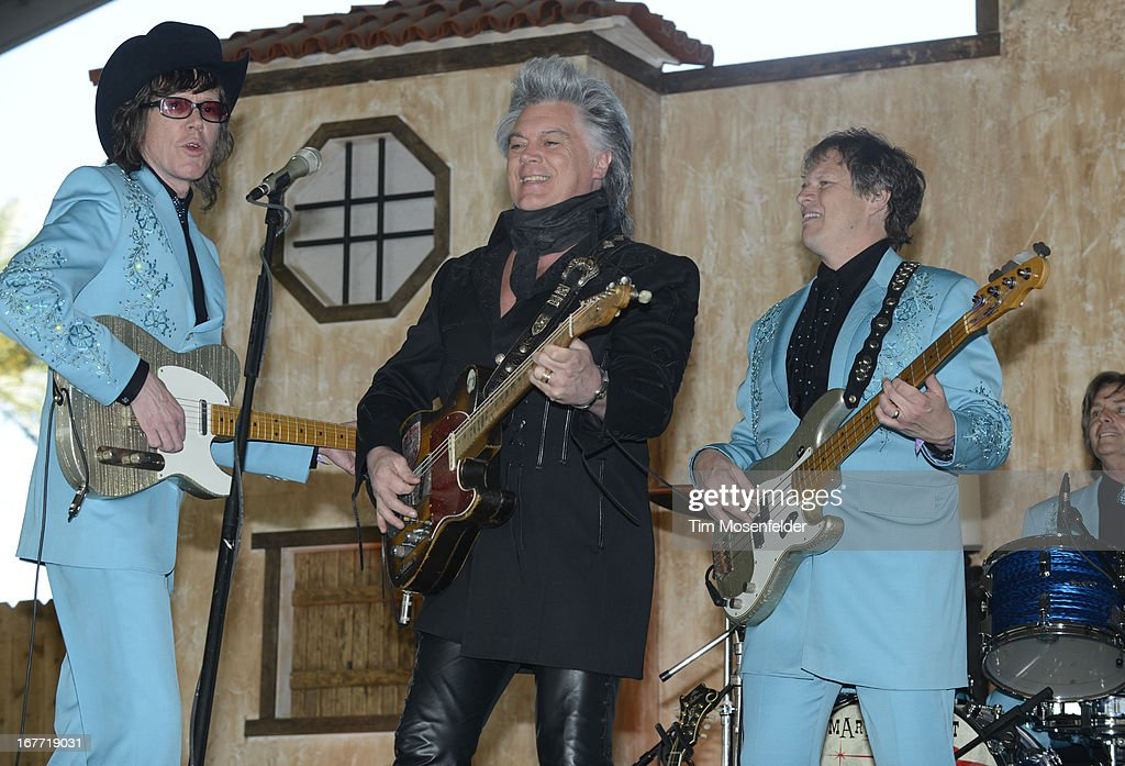 <a gi-track='captionPersonalityLinkClicked' href=/galleries/search?phrase=Marty+Stuart+-+Musicista&family=editorial&specificpeople=799797 ng-click='$event.stopPropagation()'>Marty Stuart</a> (C) performs as part of the Stagecoach Music Festival at the Empire Polo Grounds on April 27, 2013 in Indio, California.