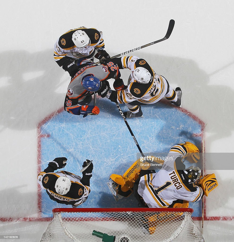 <a gi-track='captionPersonalityLinkClicked' href=/galleries/search?phrase=Marty+Turco&family=editorial&specificpeople=202549 ng-click='$event.stopPropagation()'>Marty Turco</a> #1 of the Boston Bruins covers the puck in his game against the New York Islanders at the Nassau Veterans Memorial Coliseum on March 31, 2012 in Uniondale, New York. The Bruins defeated the Islanders 6-3.