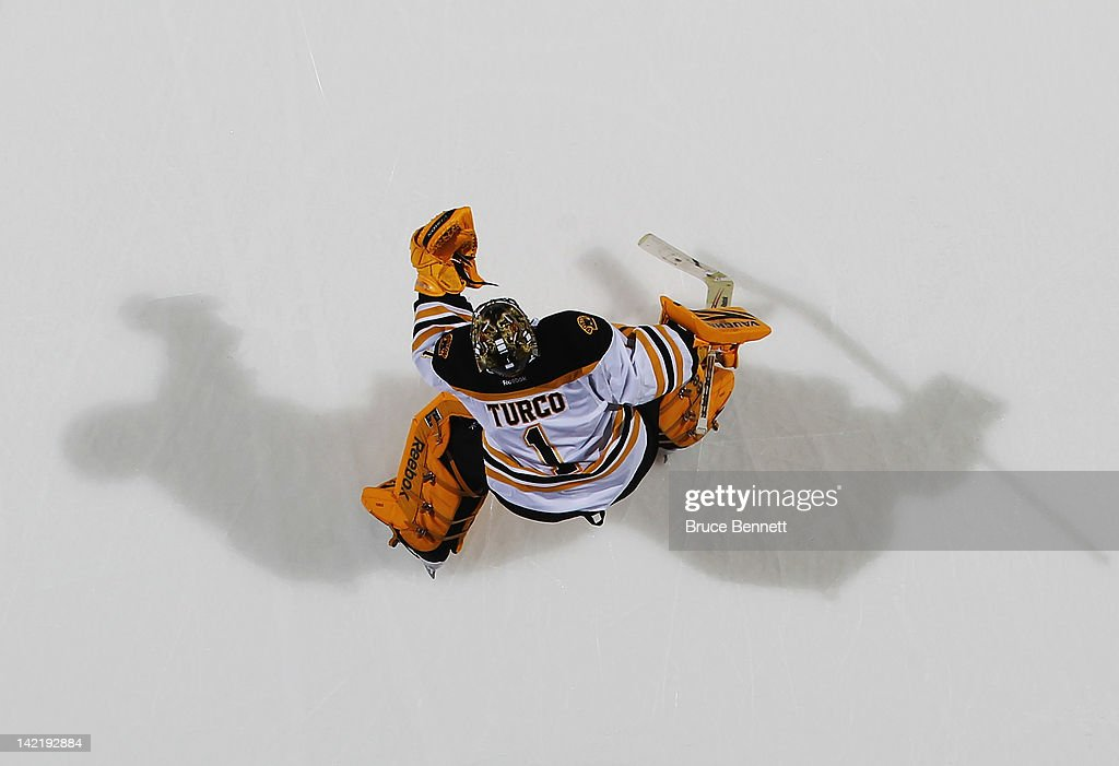 <a gi-track='captionPersonalityLinkClicked' href=/galleries/search?phrase=Marty+Turco&family=editorial&specificpeople=202549 ng-click='$event.stopPropagation()'>Marty Turco</a> #1 of the Boston Bruins makes the save against the New York Islanders at the Nassau Veterans Memorial Coliseum on March 31, 2012 in Uniondale, New York. The Bruins defeated the Islanders 6-3.